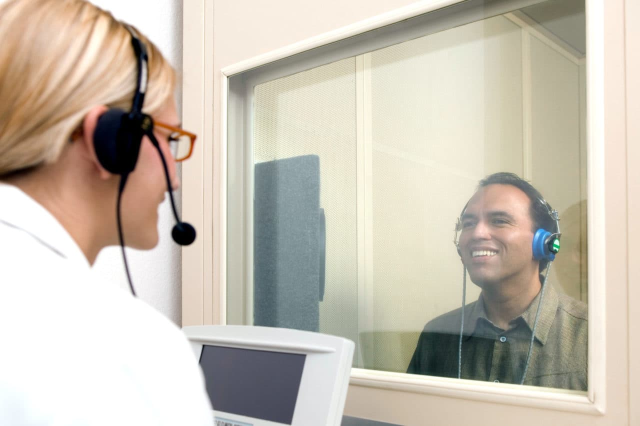 Audiologist conducting hearing test