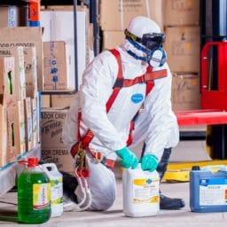 worker wearing proper protection when handling chemicals
