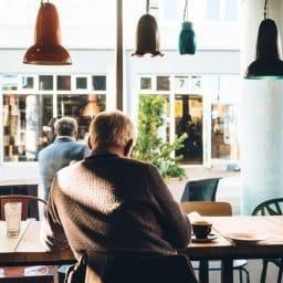 Man sits inside coffee shop